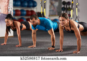 Athletic people doing crossfit training