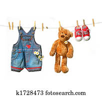 Child's clothes with teddy bear on clothesline