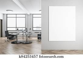 Modern office interior with blank poster on wall