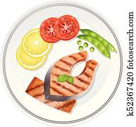 Salmon steak and vegetables on the plate