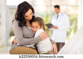 young woman and her sick daughter waiting in doctor's room