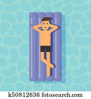 Young man floating on a mattress in a swimming pool