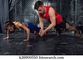 Sportsmen. fit male trainer man and woman doing clapping push-ups explosive strength training concept crossfit fitness workout strenght power