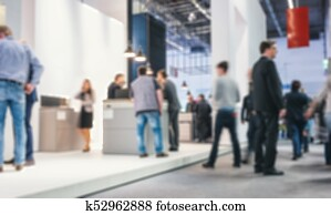 Abstract blurred people on a trade fair generic background with blur effect applied