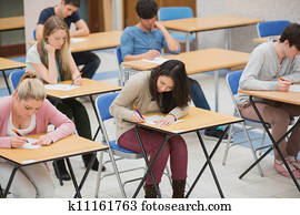 Students writing in the exam hall