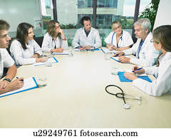 Group of doctors meeting in conference room.